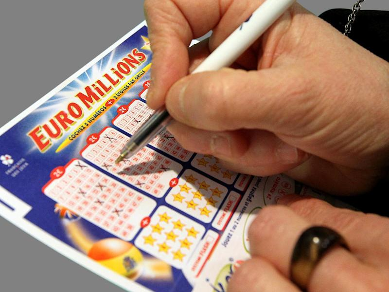 Woman fills out Euromillions lottery form, Bayonne, France, graphic element on gray