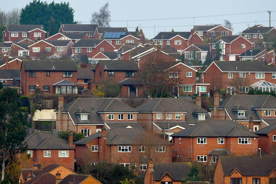 Housing accounts for 14% of UK emissions, mostly from home heating (Joe Giddens/PA) (PA Archive)