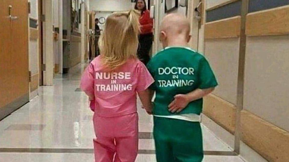 "This photo of a girl wearing ""Nurse in Training"" and boy in ""Doctor in Training"" scrubs is being slammed as sexist. (Photo: the Medical Photos)"