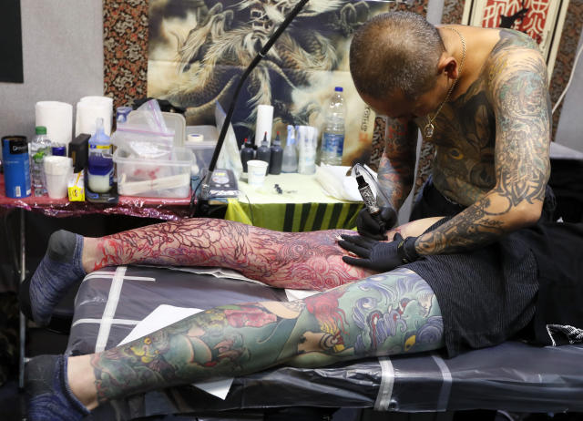 <p>A tattoo artist works at The International Tattoo Convention in London, Friday, Sept. 22, 2017. (Photo: Kirsty Wigglesworth/AP) </p>