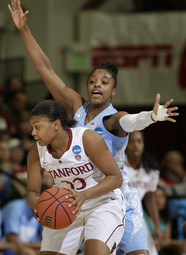 North Carolina guard Diamond DeShields, rear, defends Stanford guard Amber Orrange during the first half of a regional final of the NCAA women's college basketball tournament in Stanford, Calif., Tuesday, April 1, 2014. (AP Photo/Marcio Jose Sanchez)