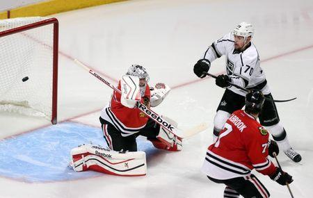 Jun 1, 2014; Chicago, IL, USA; Los Angeles Kings left wing Tanner Pearson (70) chases after the puck between Chicago Blackhawks defenseman Brent Seabrook (7) and goalie Corey Crawford during the overtime period in game seven of the Western Conference Final of the 2014 Stanley Cup Playoffs at United Center. Mandatory Credit: Dennis Wierzbicki-USA TODAY Sports