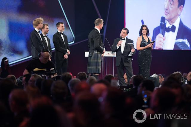 """WEC Champions Brendon Hartley, Timo Bernhard and Earl Bamber present the John Bolster award to Pierre Fillon on behalf of the Automobile Club de l'Ouest <span class=""""copyright"""">Zak Mauger / Motorsport Images</span>"""
