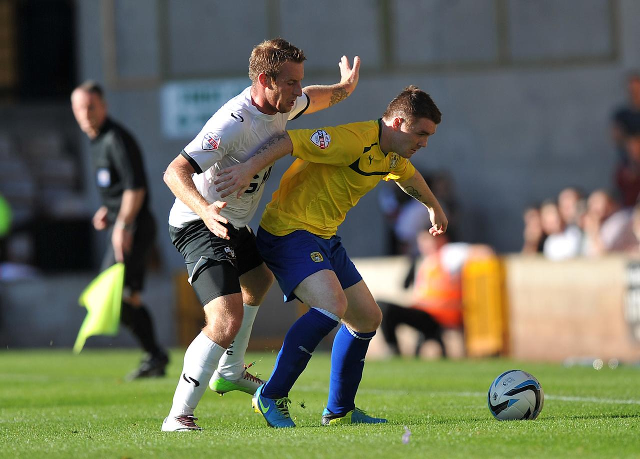 Coventry City's John Fleck (right) comes under pressure from Port Vale's Chris Birchall (left) during the Sky Bet League One match at Vale Park, Stoke.