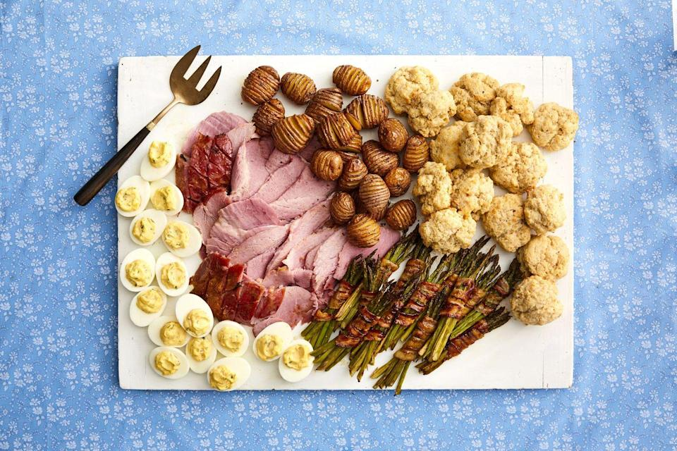 """<p>Deviled eggs are always a crowd-pleaser—they're great as both an appetizer and a side dish! Try serving your deviled eggs on a platter alongside your baked ham.</p><p><strong><a href=""""https://www.thepioneerwoman.com/food-cooking/recipes/a35566272/herbed-deviled-eggs-recipe/"""" rel=""""nofollow noopener"""" target=""""_blank"""" data-ylk=""""slk:Get the recipe."""" class=""""link rapid-noclick-resp"""">Get the recipe.</a></strong></p><p><a class=""""link rapid-noclick-resp"""" href=""""https://go.redirectingat.com?id=74968X1596630&url=https%3A%2F%2Fwww.walmart.com%2Fsearch%2F%3Fquery%3Dpioneer%2Bwoman%2Bdishes&sref=https%3A%2F%2Fwww.thepioneerwoman.com%2Ffood-cooking%2Fmeals-menus%2Fg35514088%2Fbest-side-dishes-for-ham%2F"""" rel=""""nofollow noopener"""" target=""""_blank"""" data-ylk=""""slk:SHOP DISHES"""">SHOP DISHES</a></p>"""