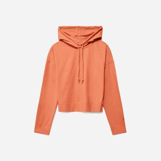 """Lounge around in your apartment while looking stylish. $48, Everlane. <a href=""""https://www.everlane.com/products/womens-retro-jersey-hoodie-terracotta?collection=womens-sale"""" rel=""""nofollow noopener"""" target=""""_blank"""" data-ylk=""""slk:Get it now!"""" class=""""link rapid-noclick-resp"""">Get it now!</a>"""
