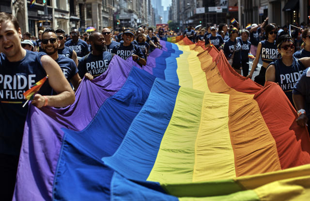 <p>Participants carry an LGBTQ flag along Fifth Avenue during the New York City Pride Parade on Sunday, June 24, 2018, in New York. (Photo: Andres Kudacki/AP) </p>