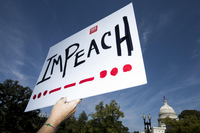 A woman holds an impeach sign as Rep. Al Green, D-Texas, and Rep. Rashida Tlaib, D-Mich., speak to a group of protesters and the media about the need to impeach President Donald Trump in front of the Rayburn House Office Building on Monday, Sept. 23, 2019. (Photo: Bill Clark/CQ-Roll Call, Inc via Getty Images)