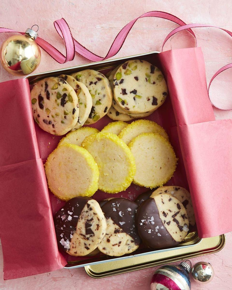 """<p>Want to watch the cookie monster in your life go crazy? Give them three flavors—chocolate, fruit and nut and lemon—of these surprisingly simple-to-make yummies.</p><p><strong><a href=""""https://www.countryliving.com/food-drinks/a34330858/slice-and-bake-shortbread-cookies/"""" rel=""""nofollow noopener"""" target=""""_blank"""" data-ylk=""""slk:Get the recipe"""" class=""""link rapid-noclick-resp"""">Get the recipe</a>.</strong></p><p><a class=""""link rapid-noclick-resp"""" href=""""https://www.amazon.com/Sanding-Sugar-Yellow-16-Oz/dp/B07NLFMPZZ/ref=sr_1_2?tag=syn-yahoo-20&ascsubtag=%5Bartid%7C10050.g.645%5Bsrc%7Cyahoo-us"""" rel=""""nofollow noopener"""" target=""""_blank"""" data-ylk=""""slk:SHOP YELLOW SANDING SUGAR"""">SHOP YELLOW SANDING SUGAR</a></p>"""