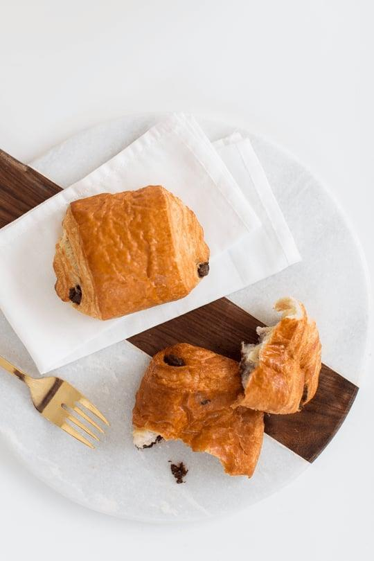 """<p>Pastry dough and semisweet chocolate chips re-create the beloved Starbucks chocolate croissant in no time. Pair this with your morning cup of coffee, and your day will be off to a good start.</p> <p><strong>Original Starbucks Food:</strong> <a href=""""http://www.starbucks.com/menu/food/bakery/chocolate-croissant"""" class=""""link rapid-noclick-resp"""" rel=""""nofollow noopener"""" target=""""_blank"""" data-ylk=""""slk:chocolate croissant"""">chocolate croissant</a></p> <p><strong>Homemade Version:</strong> <a href=""""http://sugarandcloth.com/2015/02/two-ingredient-chocolate-croissant-recipe/"""" class=""""link rapid-noclick-resp"""" rel=""""nofollow noopener"""" target=""""_blank"""" data-ylk=""""slk:two-ingredient chocolate croissant"""">two-ingredient chocolate croissant</a></p>"""