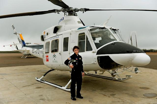 <p>Carla Rozalen, 29, a helicopter pilot, poses for a picture in front of a Bell 412 twin-engine utility helicopter at the FAASA Group in Palma del Rio, Cordoba, on February 27, 2018. (Photo: Cristina Quicler/AFP/Getty Images) </p>