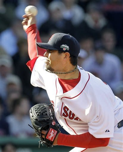 Boston Red Sox starting pitcher Josh Beckett fires a pitch to the Tampa Bay Rays during the eighth inning of a baseball game at Fenway Park in Boston, Friday, April 13, 2012. (AP Photo/Elise Amendola)