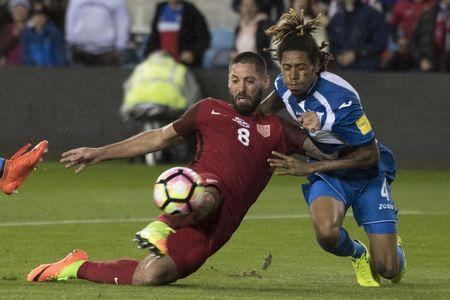 March 24, 2017; San Jose, CA, USA; United States forward Clint Dempsey (8) scores a goal against Honduras defender Henry Figueroa (4) during the first half of the Men's World Cup Soccer Qualifier at Avaya Stadium. Mandatory Credit: Kyle Terada-USA TODAY Sports