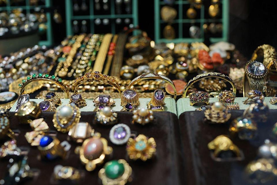 """<p>Though pieces may look expensive in the store, they're often costume jewelry, which was <a href=""""https://vintagedancer.com/1950s/1950s-jewelry-styles-trends/"""" rel=""""nofollow noopener"""" target=""""_blank"""" data-ylk=""""slk:popular in the 1950s"""" class=""""link rapid-noclick-resp"""">popular in the 1950s</a>. Unless you <em>love </em>a piece, jewelry isn't worth splurging on at thrift store, as it's probably overpriced.  </p>"""