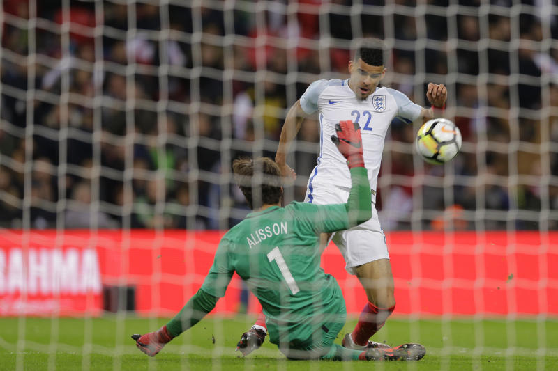 Brazil's goalkeeper Alisson saves before England's Dominic Solanke can score during the international friendly soccer match between England and Brazil at Wembley stadium in London, Britain, Tuesday, Nov. 14, 2017. (AP Photo/Alastair Grant)