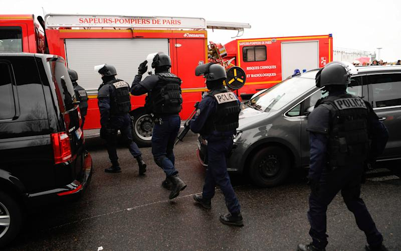 French policemen and firefighters secure the area at Paris' Orly airport  - Credit: AFP/Getty Images