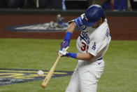Los Angeles Dodgers' Cody Bellinger hits a two-run home run against the Tampa Bay Rays during the fourth inning in Game 1 of the baseball World Series Tuesday, Oct. 20, 2020, in Arlington, Texas. (AP Photo/Tony Gutierrez)