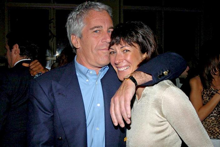 Jeffrey Epstein and Ghislaine Maxwell at a party togetherGetty