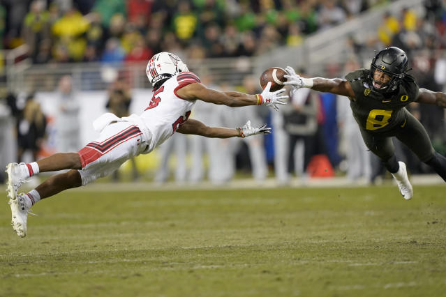 Oregon safety Jevon Holland (8) breaks up a pass for Utah wide receiver Jaylen Dixon (25) during the first half of the Pac-12 Conference championship NCAA college football game in Santa Clara, Calif., Friday, Dec. 6, 2018. (AP Photo/Tony Avelar)