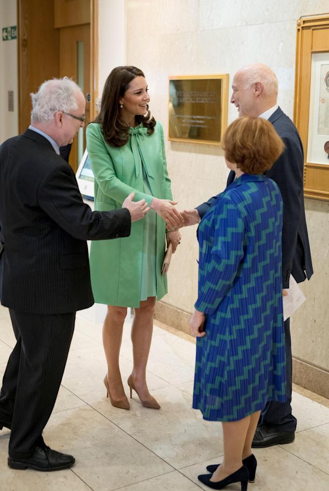 Britain's Catherine, Duchess of Cambridge is greeted by Simon Charles Wessely at the Royal Society of Medicine, in London, Britain March 21, 2018. Geoff Pugh/Pool via Reuters