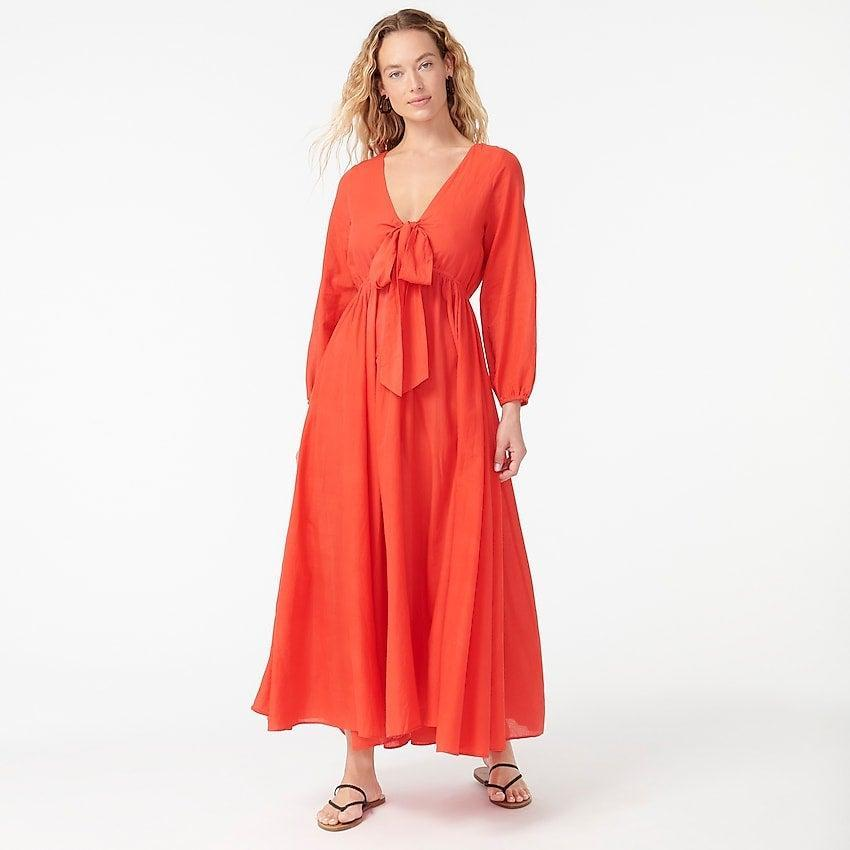 """<br><br><strong>J.Crew</strong> Tie-front cotton-voile maxi dress, $, available at <a href=""""https://go.skimresources.com/?id=30283X879131&url=https%3A%2F%2Fwww.jcrew.com%2Fp%2Fwomens%2Fcategories%2Fclothing%2Fdresses-and-jumpsuits%2Ftie-front-cotton-voile-maxi-dress%2FAY398%3Fdisplay%3Dsale%26fit%3DClassic%26isFromSale%3Dtrue%26color_name%3Dneon-poppy%26colorProductCode%3DAY398"""" rel=""""nofollow noopener"""" target=""""_blank"""" data-ylk=""""slk:J. Crew"""" class=""""link rapid-noclick-resp"""">J. Crew</a>"""