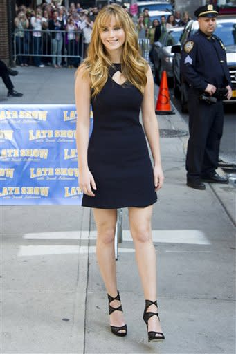 """Jennifer Lawrence arrives for an appearance on the """"Late Show with David Letterman"""" in New York, Tuesday, March 20, 2012. (AP Photo/Charles Sykes)"""