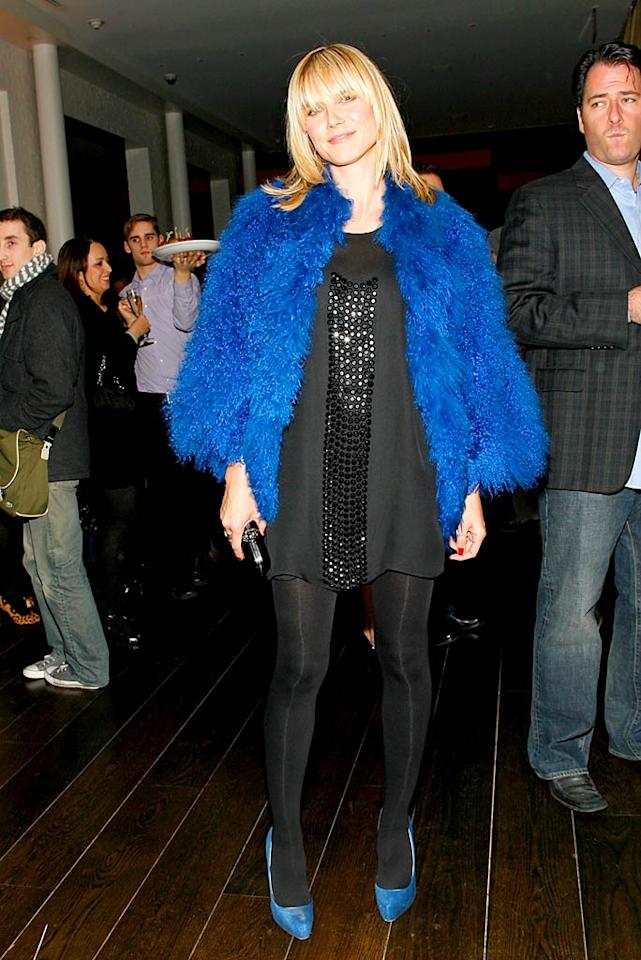 "We wonder what Heidi's ""Project Runway"" co-stars would think of this questionable ensemble. Perhaps Tim Gunn, Nina Garcia, and Michael Kors would say ""Auf Wiedersehen"" to the Muppet-like jacket and matching blue pumps. Mark Von Holden/<a href=""http://www.wireimage.com"" target=""new"">WireImage.com</a> - January 31, 2008"