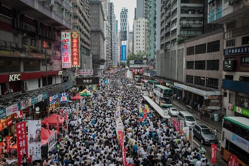 Demonstrators march during a pro-democracy rally seeking greater democracy in Hong Kong on July 1, 2014 as frustration grows over the influence of Beijing on the city