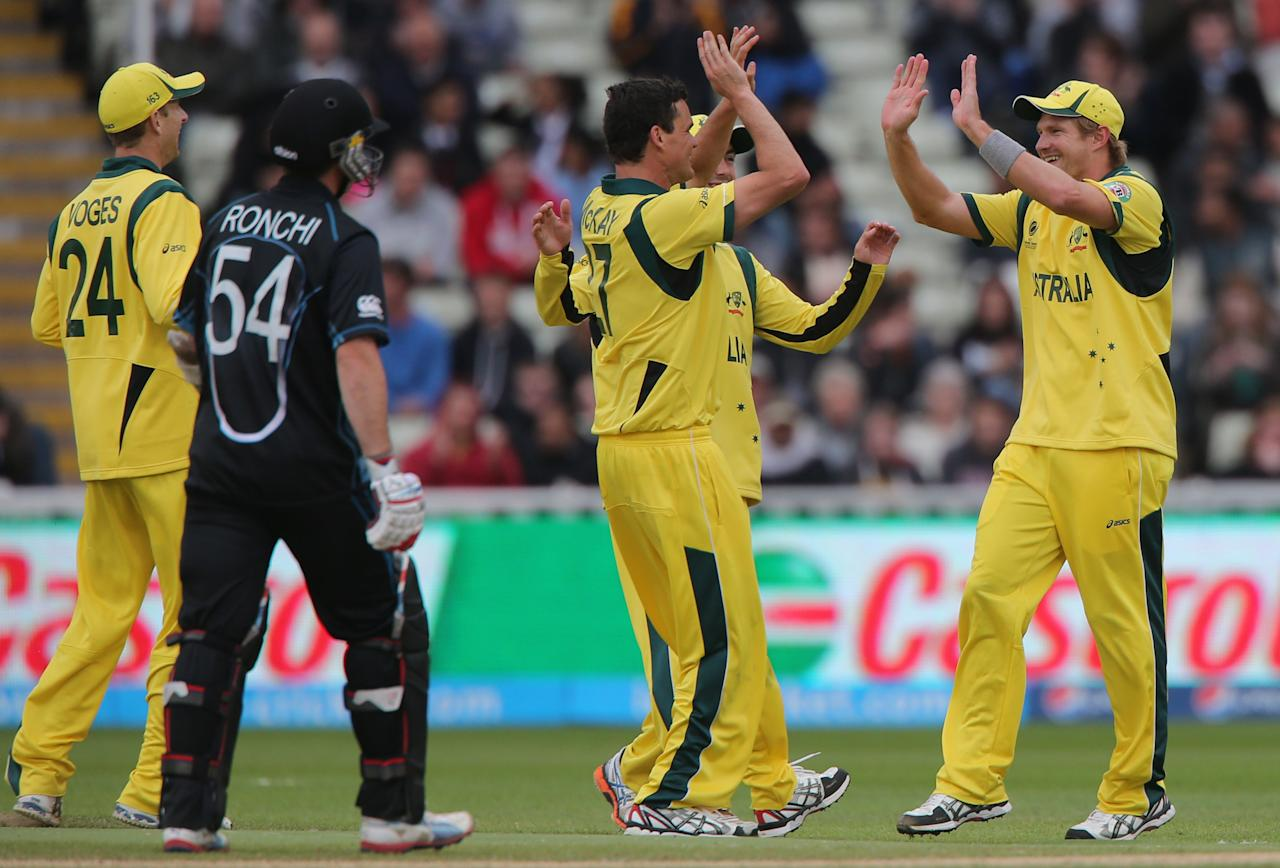 Australia's Shane Watson celebrates catching New Zealand batsman Luke Ronchi off bowler Clint McKay. The ICC Champions Trophy match at Edgbaston, Birmingham.