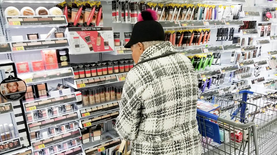 Columbus, Ohio December 5, 2019: Elderly lady shops in the cosmetic aisle at local Walmart.