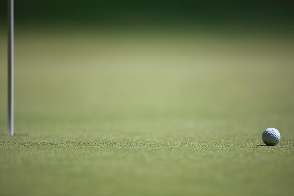 A generic image of a golf ball near the pin