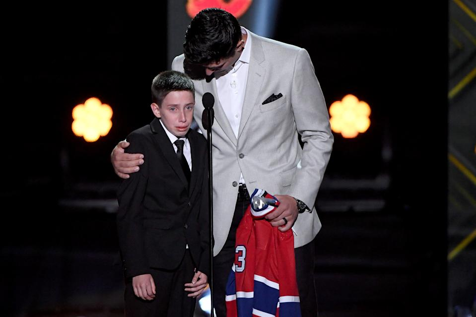 LAS VEGAS, NEVADA - JUNE 19: Carey Price of the Montreal Canadiens presents friend Anderson Whitehead a jersey and a trip to the 2020 NHL All-Star game during the 2019 NHL Awards at the Mandalay Bay Events Center on June 19, 2019 in Las Vegas, Nevada. (Photo by Ethan Miller/Getty Images)
