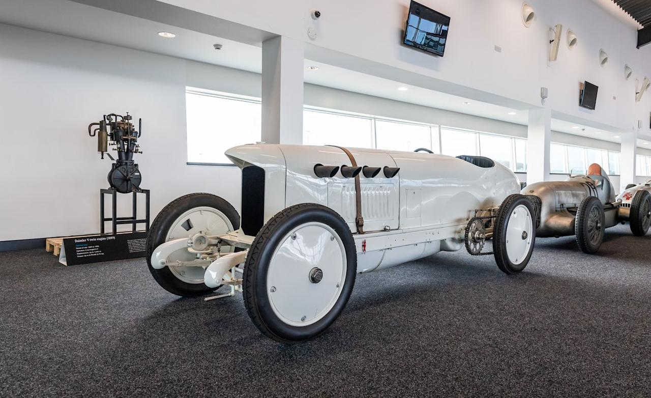 <p>One of the most significant, and coolest, of Daimler's pre-war competition cars is the 1909 Benz 200 hp, better known as the Blitzen Benz. With its 21.5-liter inline-four, it set a range of top-speed records in Europe and the United States, ultimately reaching 142 mph (Yes, it still runs fine.) Notice the hand-crank-started 1.6-liter V-twin in the background (3.8 horsepower), which kickstarted Daimler's competition efforts when it powered Peugeot and Panhard & Levassor racers to victory in the 1894 Paris-Rouen race, the world's first automotive competition. </p>