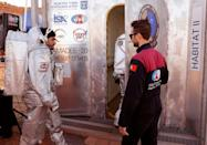 An astronaut from the team enters the sealed habitat, to be supervised by a Mission Support Center in Austria (AFP/JACK GUEZ)
