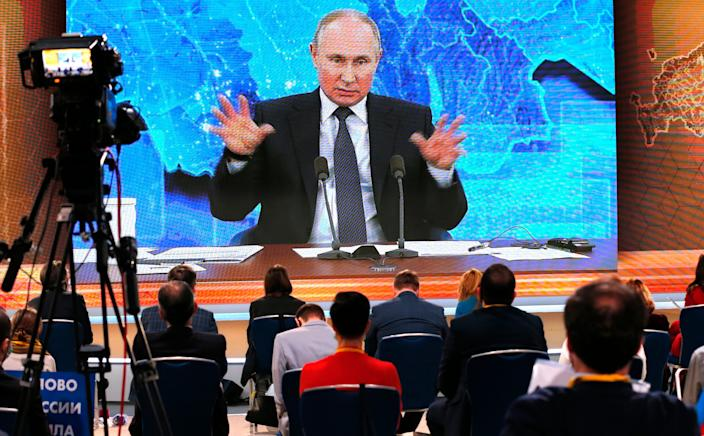 Russian President Vladimir Putin speaks via video call during his annual year-end news conference in Moscow on Dec. 17, 2020.