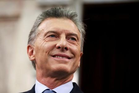 FILE PHOTO: Argentina's President Mauricio Macri smiles as he arrives at the opening session of the 137th legislative term in Buenos Aires