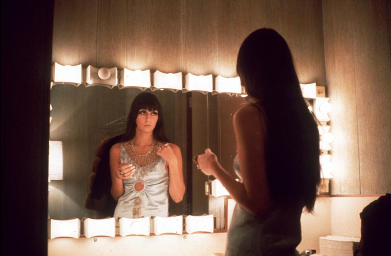 LOS ANGELES - MARCH 1968: Entertainer Cher fixes her make up in a dressing room mirror in March 1968 in Los Angeles, California. (Photo by Michael Ochs Archives/Getty Images)