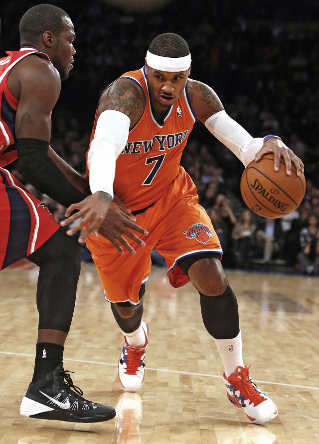 New York Knicks' Carmelo Anthony (7) drives against Atlanta Hawks' Paul Millsap, left, during the first half of an NBA basketball game Saturday, Nov. 16, 2013, in New York. (AP Photo/Jason DeCrow)