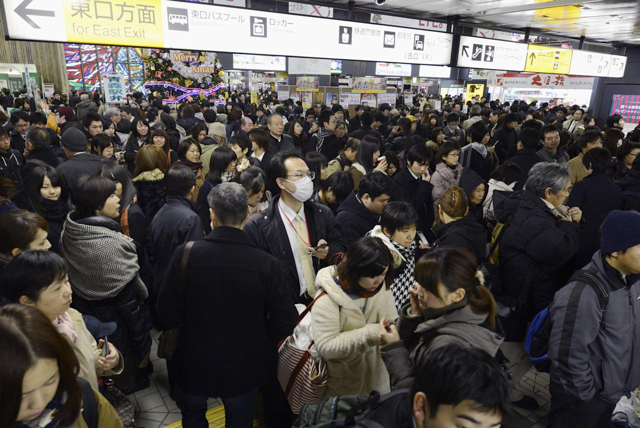People crowd at Sendai railway station in Sendai, Miyagi Prefecture, Friday, Dec. 7, 2012 after trains were halted following a strong earthquake struck off the coast of northeastern Japan. It is the same region that was hit by a massive earthquake and tsunami last year. (AP Photo/Kyodo News) JAPAN OUT, MANDATORY CREDIT, NO LICENSING IN CHINA, FRANCE, HONG KONG, JAPAN AND SOUTH KOREA