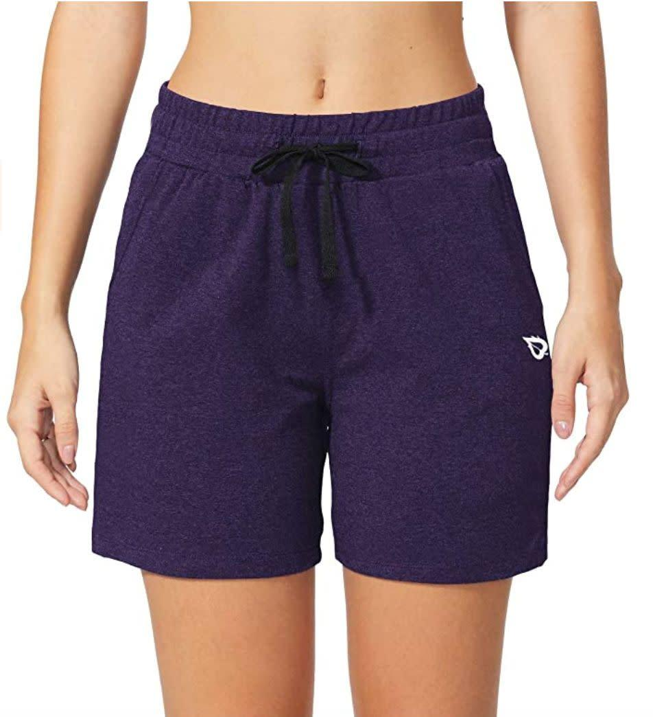 "These <a href=""https://amzn.to/3gSam1c"" rel=""nofollow noopener"" target=""_blank"" data-ylk=""slk:cotton shorts"" class=""link rapid-noclick-resp"">cotton shorts</a> (they have a hint of spandex in them as well) feature a drawstring waist and side and back pockets for anything you might need on a walk. They're high-waisted to pair with cropped tees. <br><br><strong>Sizes:</strong> These shorts come in sizes XS to 3X. <br><strong>Rating:</strong> They have a 4.3-star rating over more than 1,600 reviews. <br><strong>$$$:</strong> <a href=""https://amzn.to/3gSam1c"" rel=""nofollow noopener"" target=""_blank"" data-ylk=""slk:Find them for $23 at Amazon"" class=""link rapid-noclick-resp"">Find them for $23 at Amazon</a>."