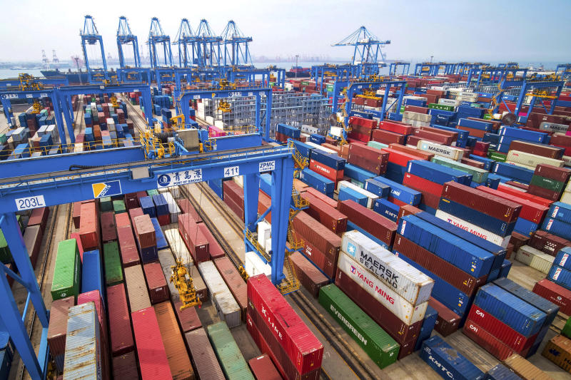 FILE - In this May 14, 2019, fiel photo, containers are piled up at a port in Qingdao in east China's Shandong province. China's economic growth slowed to a 26-year low in the latest quarter as a tariff war with Washington weighed on exports and auto sales and other domestic activity weakened. The world's second-largest economy expanded by 6.2 percent in the three months ending in September, down from the previous quarter's 6 percent, data showed Friday, Oct. 18, 2019. (Chinatopix via AP, File)