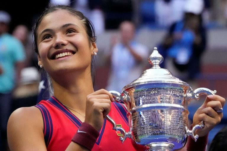 Winning smile: Britain's Emma Raducanu celebrates with the US Open trophy after becoming the first qualifier in history to win a Grand Slam (AFP/TIMOTHY A. CLARY)