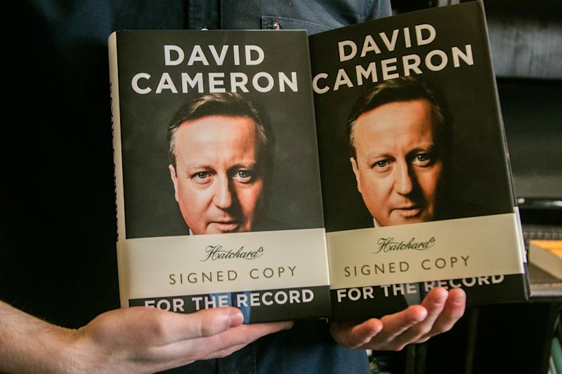 "Hands of a person hold signed copies of the autobiography book "" For the Record"" by the former British Prime Minister David Cameron at Hatchards bookstore in Piccadilly, London. (Photo by Amer Ghazzal / SOPA Images/Sipa USA)"