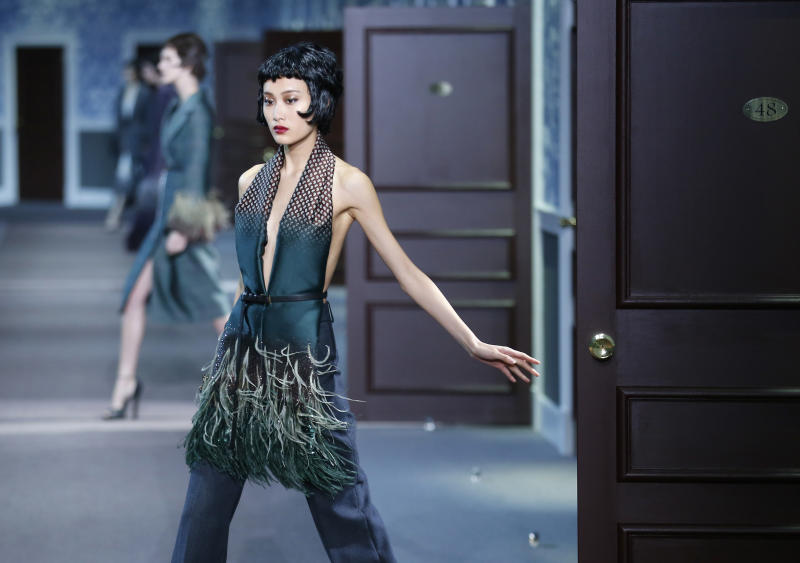 Moss upstages Vuitton hotel, capping fashion week 1810b581bec