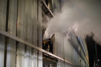 Protestors trigger a fire extinguisher at El Prat airport in Barcelona, Spain, Monday, Oct. 14, 2019. Riot police have charged at protesters outside Barcelona's airport after the Supreme Court sentenced 12 prominent Catalan separatists to lengthy prison terms for their roles in a 2017 push for the wealthy Spanish region's independence. (AP Photo/Emilio Morenatti)