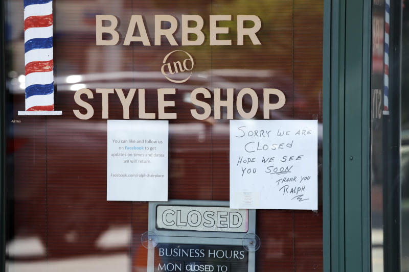 A barber shop remains closed because of the coronavirus outbreak Tuesday, May 19, 2020, in Seattle. Washington state Gov. Jay Inslee on Tuesday announced $10 million in grants to small businesses in industries particularly hard-hit by the COVID-19 outbreak. They include restaurants, hair salons, fitness studios and theaters. (AP Photo/Elaine Thompson)