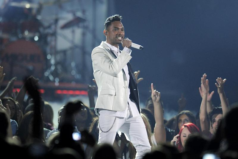 FILE - In this May 19, 2013 file photo, Miguel performs at the Billboard Music Awards at the MGM Grand Garden Arena, in Las Vegas. The attorney for a woman whose head was hit after Miguel leaped into the crowd during the Billboard Music Awards in May said Thursday, June 13, 2013, that his client continues to suffer cognitive difficulties and has not received any assistance from the R&B singer or show producers.(Photo by Chris Pizzello/Invision/AP, File)