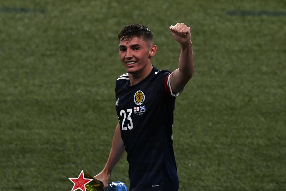 FILE - In this Friday, June 18, 2021 file photo Scotland's Billy Gilmour waves to the fans after the Euro 2020 soccer championship group D match between England and Scotland, at Wembley stadium, in London. Scotland midfielder Billy Gilmour has tested positive for the coronavirus and will have to isolate for 10 days. The Chelsea player will miss Scotland's final Group D match against Croatia on Tuesday and a potential round-of-16 match. (Facundo Arrizabalaga/Pool via AP, File)