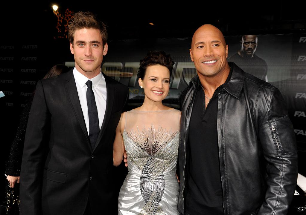 """<a href=""""http://movies.yahoo.com/movie/contributor/1810173056"""">Oliver Jackson-Cohen</a>, <a href=""""http://movies.yahoo.com/movie/contributor/1800024683"""">Carla Gugino</a> and <a href=""""http://movies.yahoo.com/movie/contributor/1808442134"""">Dwayne Johnson</a> at the Los Angeles premiere of <a href=""""http://movies.yahoo.com/movie/1810147419/info"""">Faster</a> on November 22, 2010."""