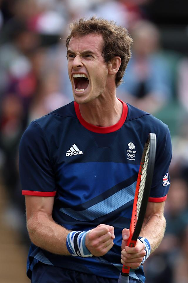 LONDON, ENGLAND - AUGUST 01: Andy Murray of Great Britain celebrates after defeating Marcos Baghdatis of Cyprus during the third round of Men's Singles Tennis on Day 5 of the London 2012 Olympic Games at Wimbledon on August 1, 2012 in London, England. (Photo by Clive Brunskill/Getty Images)